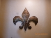 Metal Fleur d'Lis on Mottled Wall