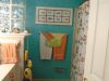 Bath in tone-on-tone walls/painted cabinets