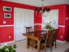 Dining area after chair rail and 2 shades of red paint