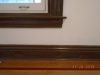 Living room baseboard and window sill after faux wood grained