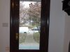 Entry door after  refinishing in a faux wood grain