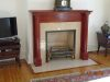 Antique wooden mantle before restoration