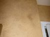 Rustic mottling in hall bath