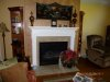 White wood mantle and Restored and rehung tapestry