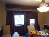 Large cornice with heavy drapes /dining room